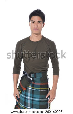 Shot of a young handsome man posing in studio - stock photo