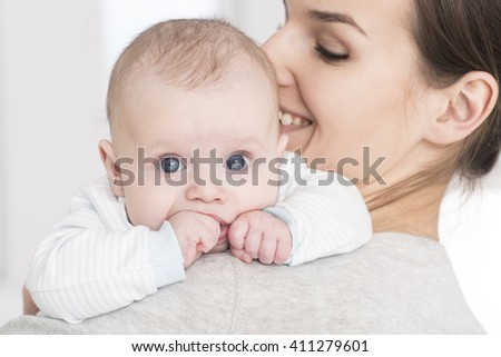 Shot of a young happy mother holding her baby