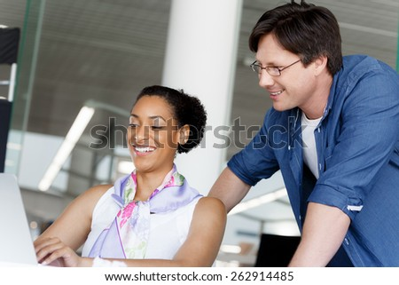 Shot of a young office worker getting some assistance from her manager
