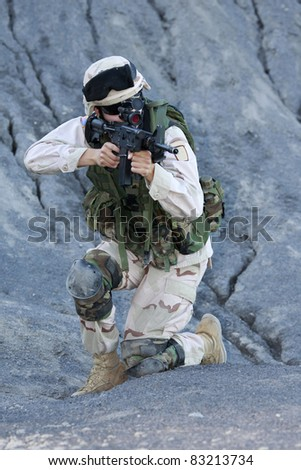 Shot of a young soldier. Uniform conforms to special services(soldiers) of the NATO countries. - stock photo