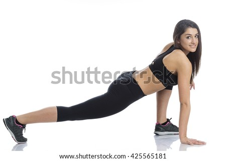 Shot of a young women stretching her leg before. Studio shot, Isolated on white. - stock photo