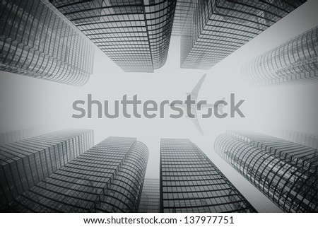Shot of airplane flying above glass office buildings in fog. Fisheye lens effect. - stock photo