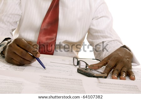 shot of an African American businessman reading newspaper sitting at the table - stock photo