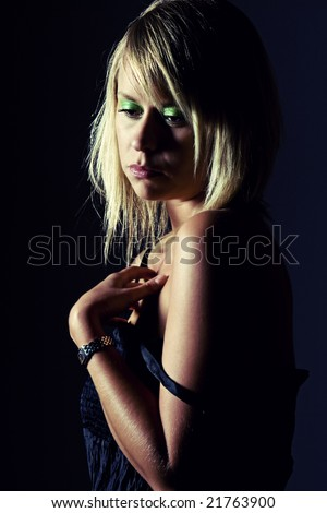 Shot of an Attractive Blonde Girl looking Depressed - stock photo