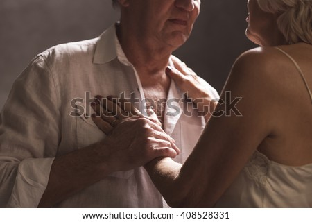 Shot of an elderly couple getting intimate