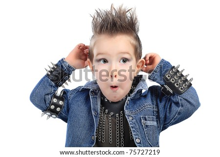 Shot of an emotional little boy wearing rock music clothes. Isolated over white background. - stock photo
