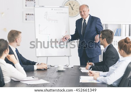 Shot of an experienced employee giving his younger colleagues advices
