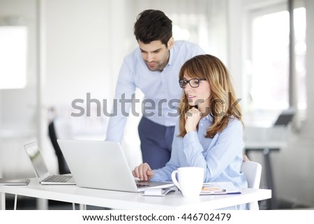 Shot of an investment advisor businesswoman and her young financial assistant working together on laptop. - stock photo