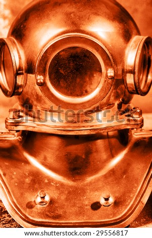 Shot of an old diving helmet - stock photo