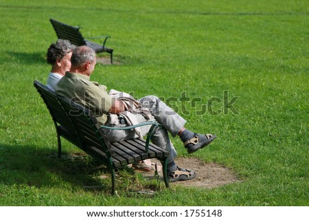 Shot of an old family couple talking in the park - stock photo