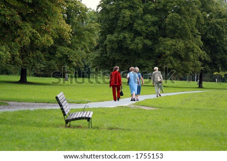 Shot of an old friends walking in the park