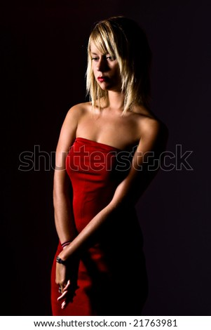 Shot of Attractive Blonde Woman in Red Dress Looking Depressed
