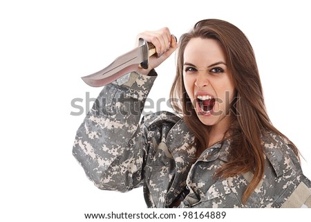 Shot of attractive girl in military uniform holding a knife isolated in white - stock photo
