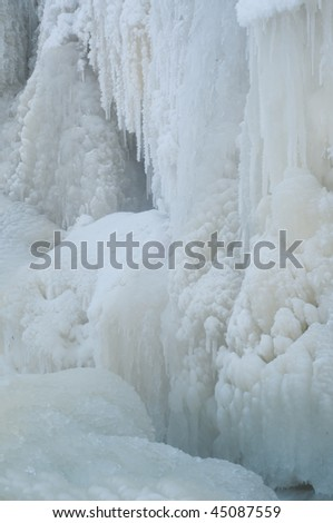 Shot of beautiful frozen waterfall in north - stock photo