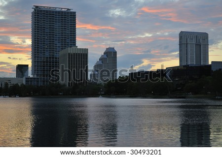Shot of buildings along Lake Eola in downtown Orlando, FL - stock photo