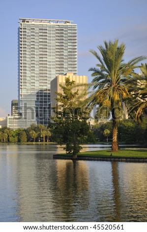 Shot of buildings in Downtown Orlando with palm trees in the foreground - stock photo