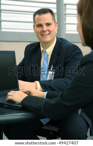 shot of business man talking with his partner while working outdoor