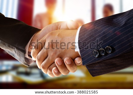 shot of businessmen handshaking.acquisition concept. - stock photo
