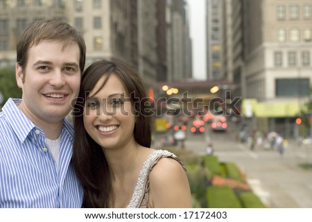 Shot of couple hugging each other while standing outside - stock photo