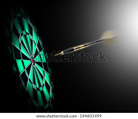Shot of darts in bullseye on dartboard - stock photo