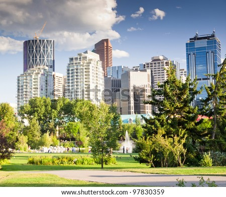 Shot of Downtown buildings from park with lots of green near by. - stock photo