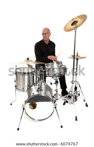 shot of drummer playing over white backdrop - stock photo