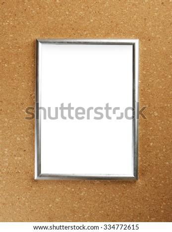 Shot of empty diploma frame on cork background - stock photo