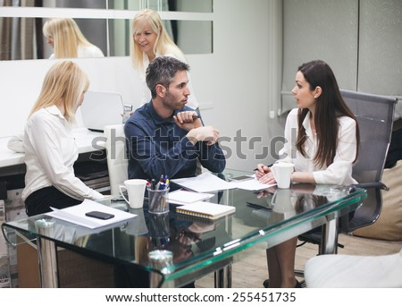 Shot of five colleagues having a meeting in the boardroom  - stock photo