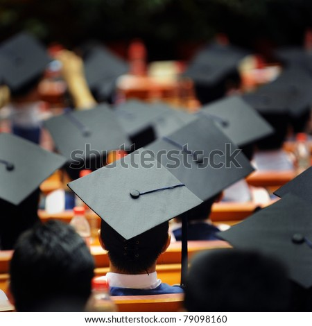 Shot of graduation caps during commencement.