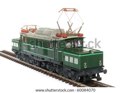 Shot of green model railway isolated on white background - stock photo