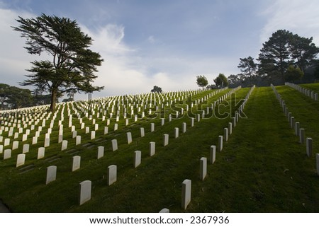 Shot of headstones in the San Francisco National Cemetery near the Golden Gate Bridge. - stock photo