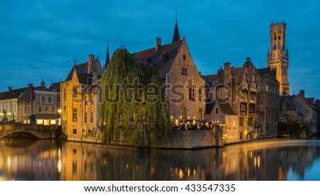 Shot of historic medieval buildings along a canal in Bruges, Belgium - stock photo