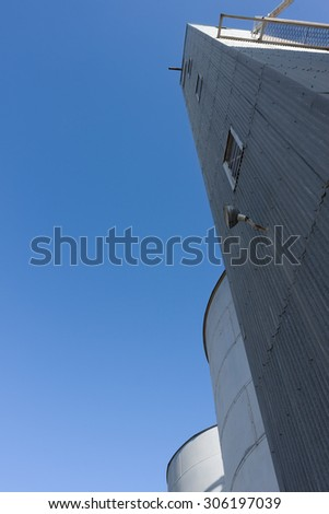 Shot of large steel silos. Clear Skies. - stock photo