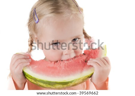 Shot of little girl eating watermelon isolated on white