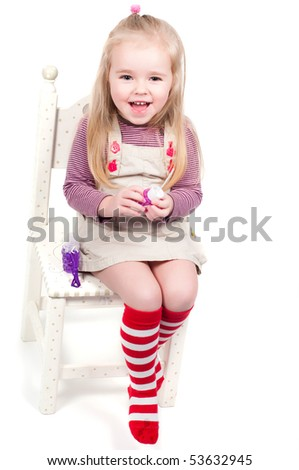 Shot of little girl, who making bubbles - stock photo
