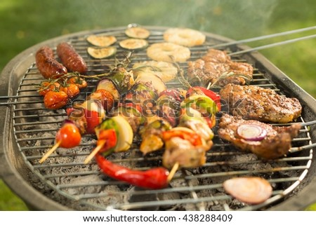 Shot of meat and vegetables on a grill