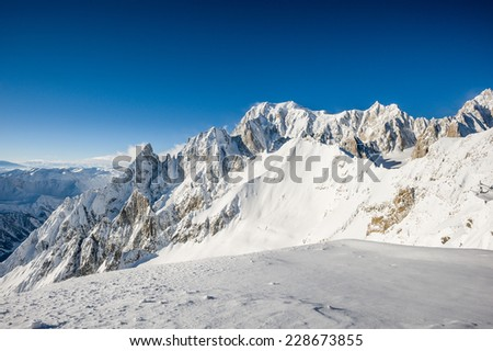 shot of mont blanc chain during a tour over the top of europe.  - stock photo