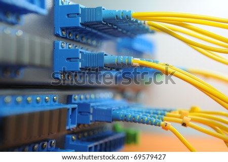 shot of network cables and hub in a technology data center - stock photo