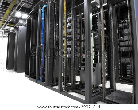 shot of network cables and servers in a technology data center(See more network cables and servers backgrounds in my portfolio). - stock photo