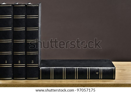 Shot of Old Books on Bookshelf - stock photo