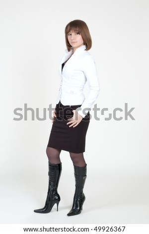 shot of positive young woman in white and black