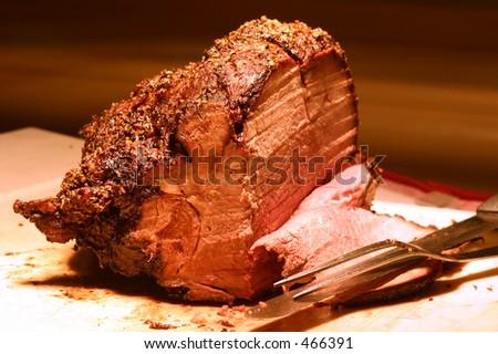 Shot of prime rib at a buffet table. Shallow DOF. - stock photo