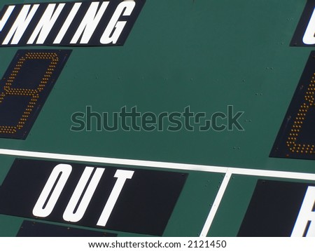 Shot of scoreboard above baseball diamond. - stock photo