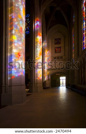Shot of stained glass streaming in in San Francisco's Grace Cathedral - stock photo