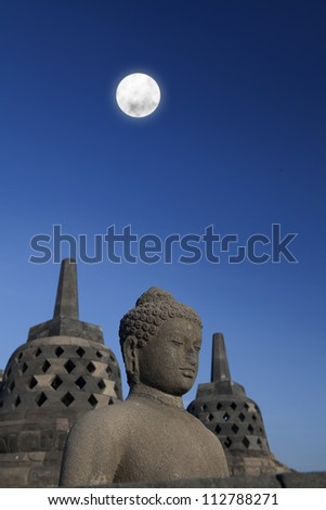 Shot of statue and stupa at borobudur temple, Yogyakarta, Java, Indonesia. - stock photo