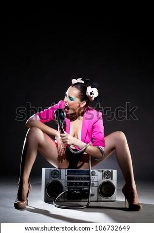 Shot of the singing girl - stock photo