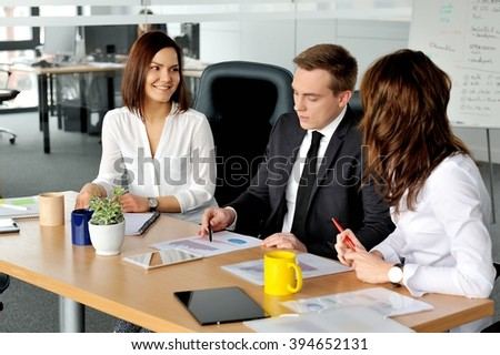Shot of three corporate businesspeople working in the office.