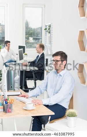 Shot of three men focused on their work in an office