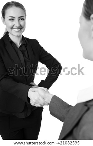 shot of two business models shaking hands.  Isolated on a white background.