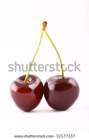 Shot of two isolated red cherries